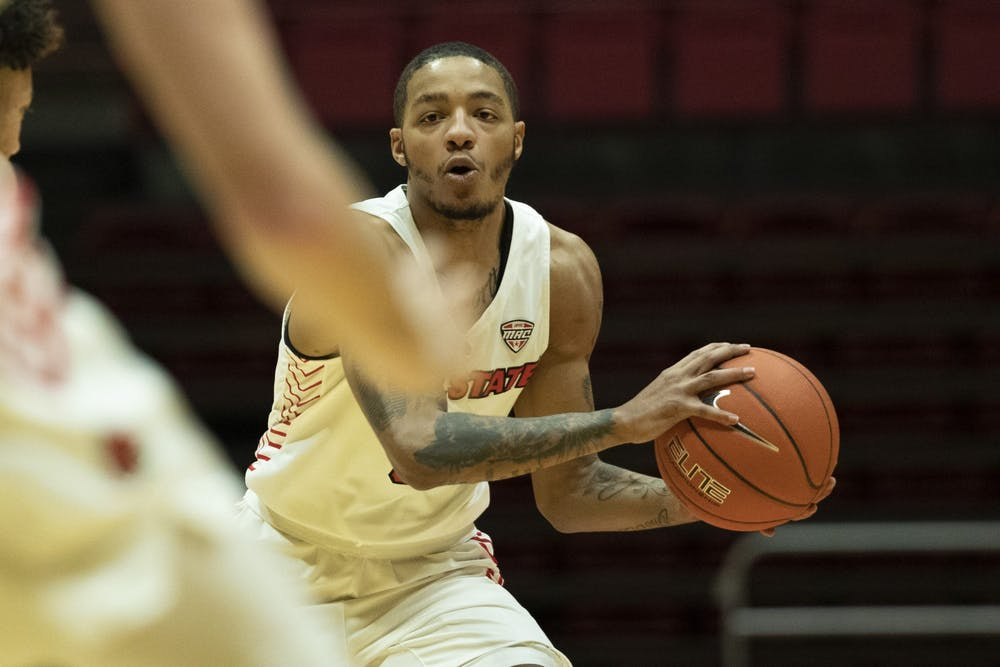 Ball State Cardinals senior guard Ishmael El-Amin looks for an open teammate during the first half of a game against the Ohio University Bobcats Jan. 2, 2020, at John E. Worthen Arena. The Cardinals lost the Bobcats 78-68. Jacob Musselman, DN