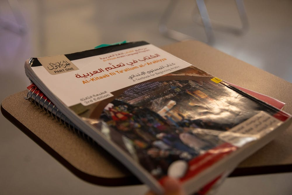 <p>An Arabic language textbook sits on a desk March 24, 2021, in the Applied Technology Building. The reintroduction of the Advancing International and Foreign Language Education Act proposes to offer federal funds to smaller collegiate world language programs across the United States. <strong>Jaden Whiteman, DN File</strong></p>