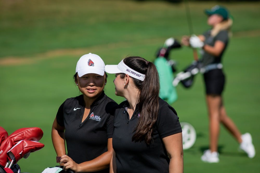 <p>Junior Liz Kim speaks with women's golf graduate assistant Marie Donnici Sept. 16, 2019, at the Players Club at Woodland Trails in Yorktown, Ind while on the back nine. Kim finished the third round four strokes above par in the Cardinal Classic. Eric Pritchett, DN</p>