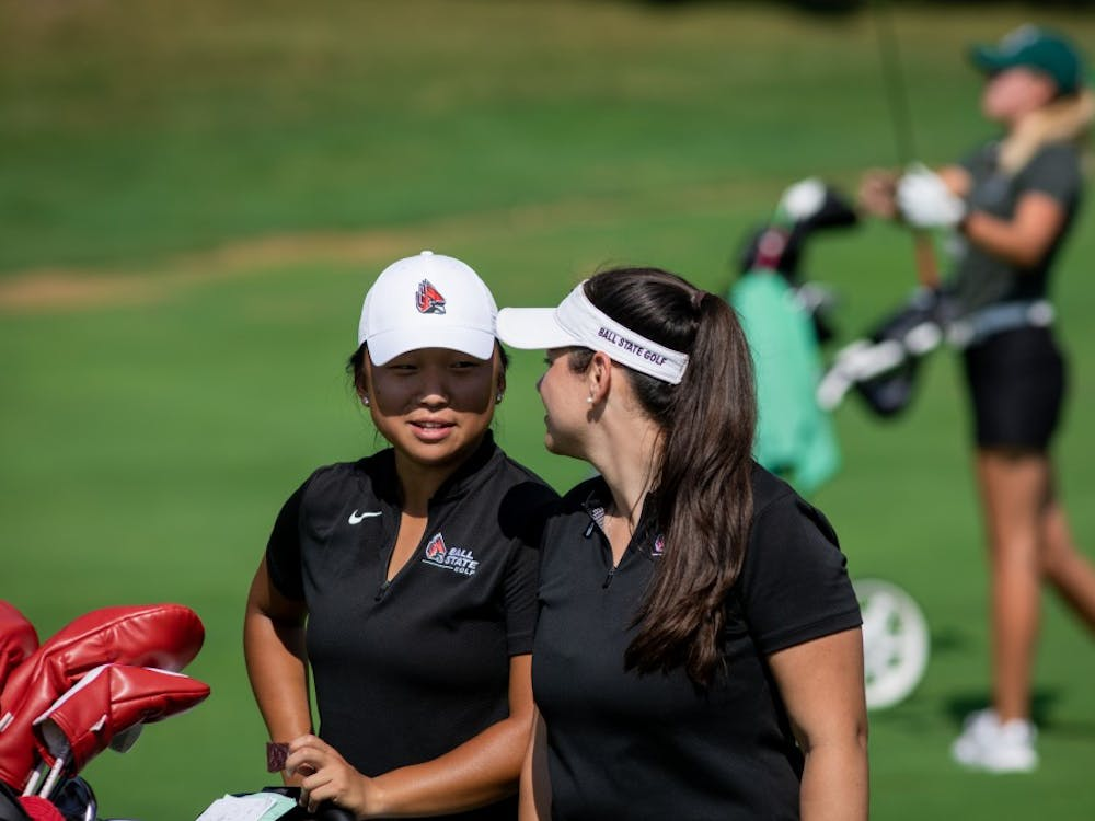Junior Liz Kim speaks with women's golf graduate assistant Marie Donnici Sept. 16, 2019, at the Players Club at Woodland Trails in Yorktown, Ind while on the back nine. Kim finished the third round four strokes above par in the Cardinal Classic. Eric Pritchett, DN