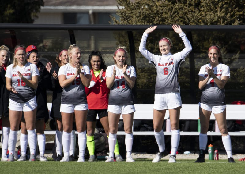 Cardinals senior defender Emily Simmons waves to the crowd as she's introduced before Ball State's home season opener against the Toledo Rockets March 4, 2021, at Briner Sports Complex. The Cardinals beat the Rockets 2-0. Jacob Musselman, DN