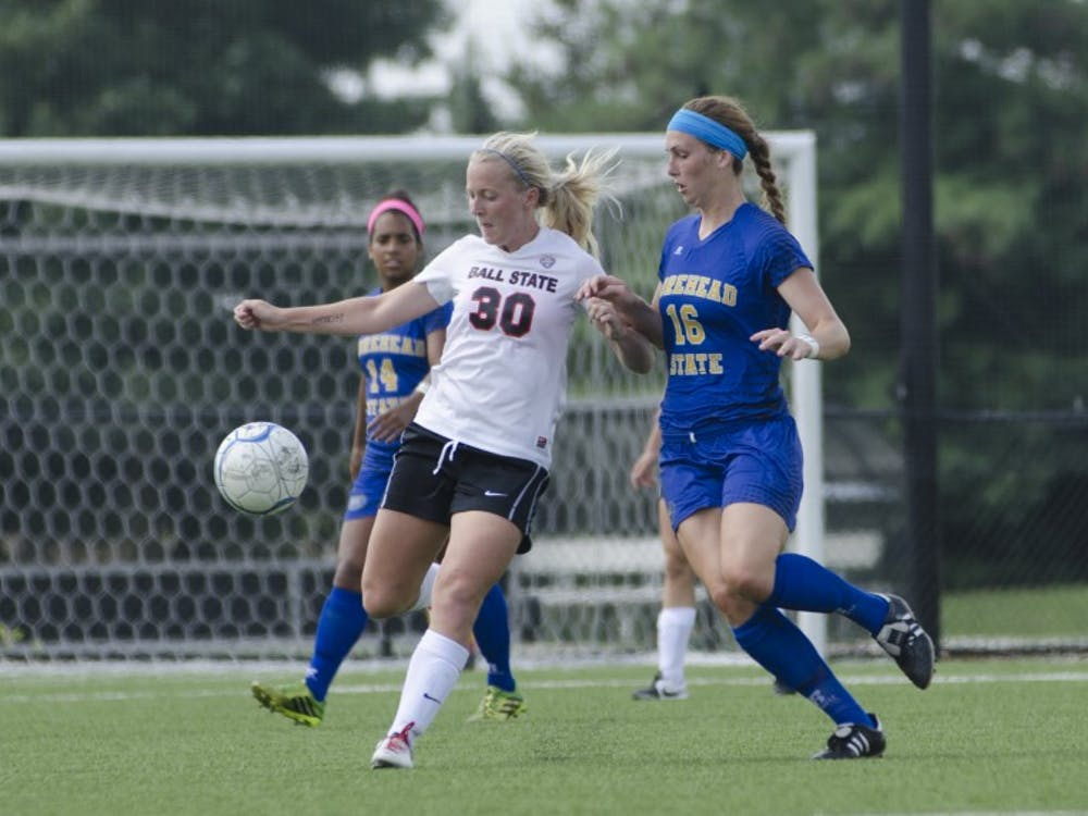 Junior midfielder Kaylynn Flanagan attempts to hit the ball during the soccer game against Moorehead State on Aug. 31 at the Briner Sports Complex. DN PHOTO BREANNA DAUGHERTY