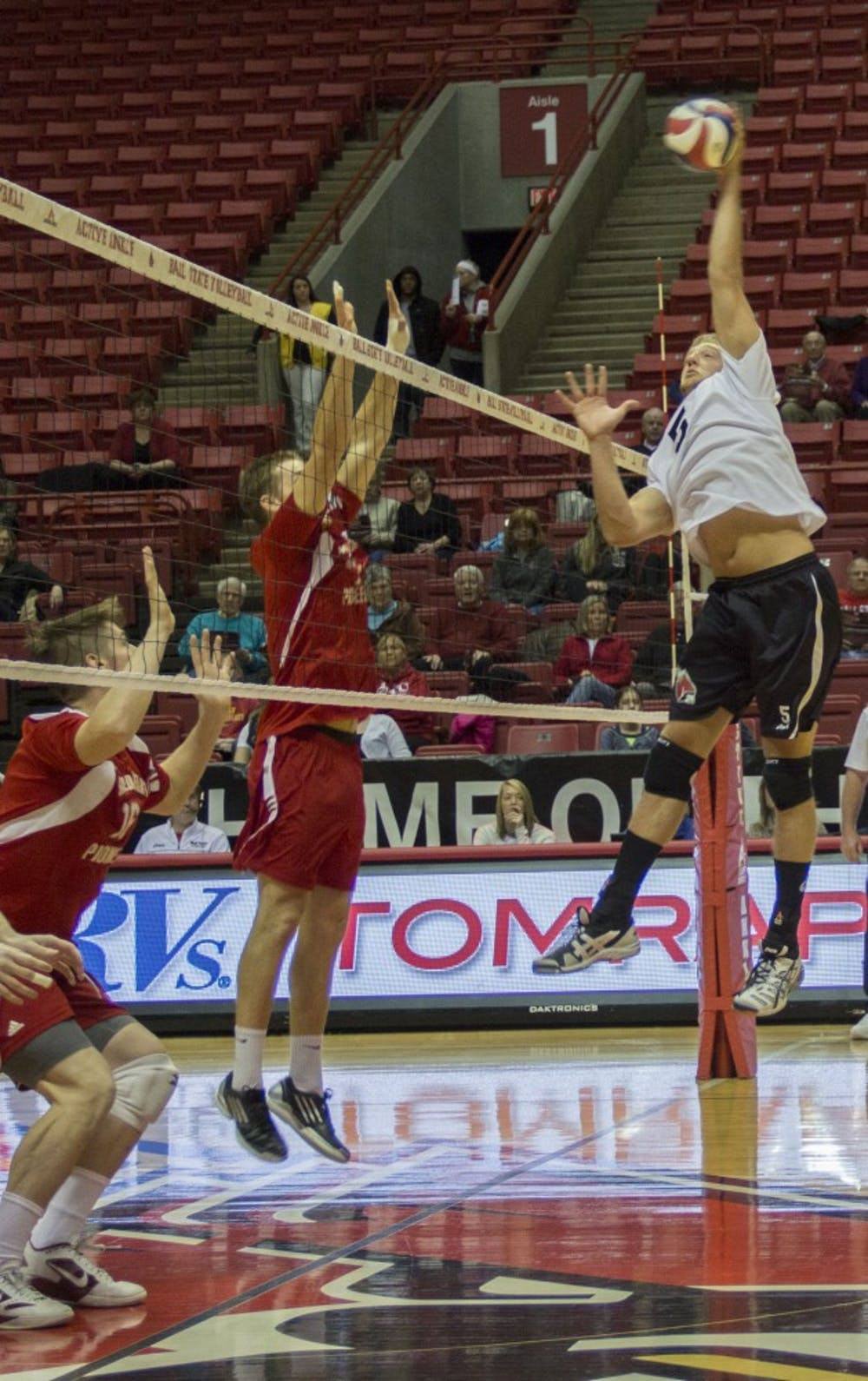 Graham McIlvaine, a senior setter, hits the ball against Sacred Heart on Jan. 11. After three sets, Ball State won the match, bringing its record to 1-1. DN PHOTO EMMA ROGERS