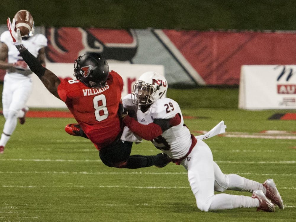 In a nationally televised contest, Ball State and Northern Illinois battled for the Bronze Stalk on Wednesday evening. The Game, which ran into the night, was mostly dominated by NUI's running offense. DN PHOTO JONATHAN MIKSANEK