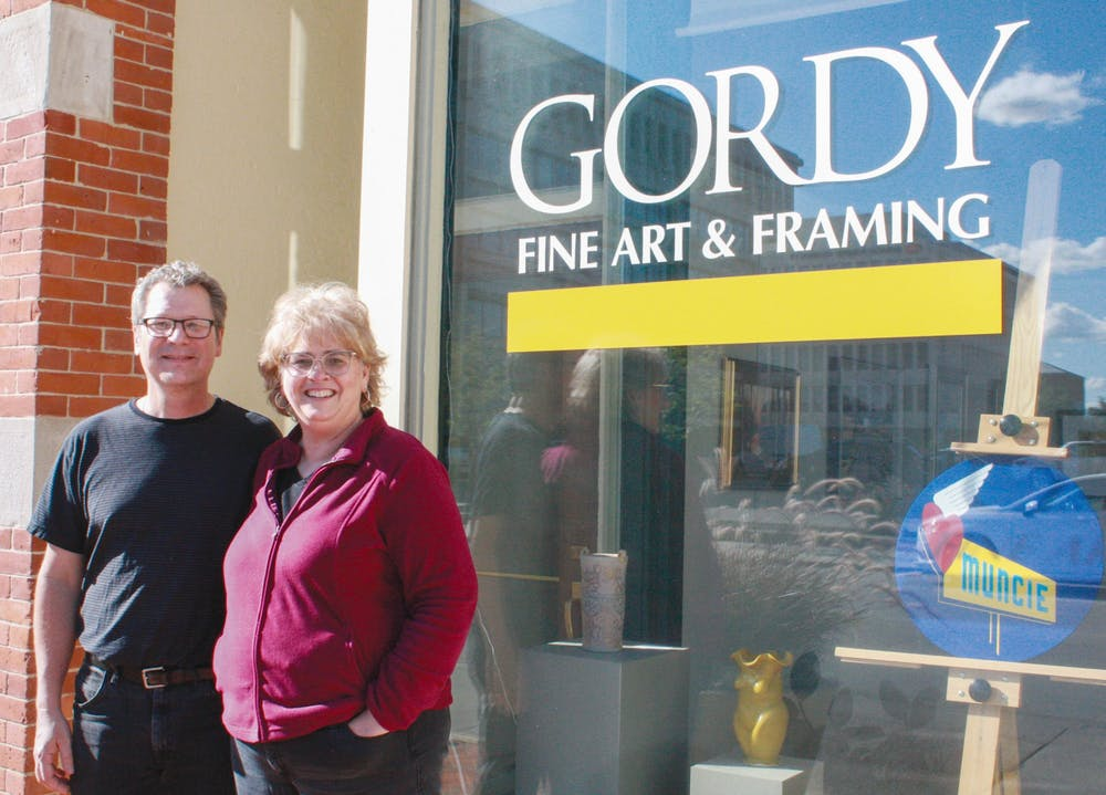 <p>Carl and Barbara Schafer pose outside of Gordy Fine Art and Framing located at 224 E. Main Street, Sept. 9, 2021. Since purchasing Gordy in 2015, the Schafers have grown their reputation as a high-quality frame creation, reproduction and restoration shop. Samantha Lyon, DN</p>