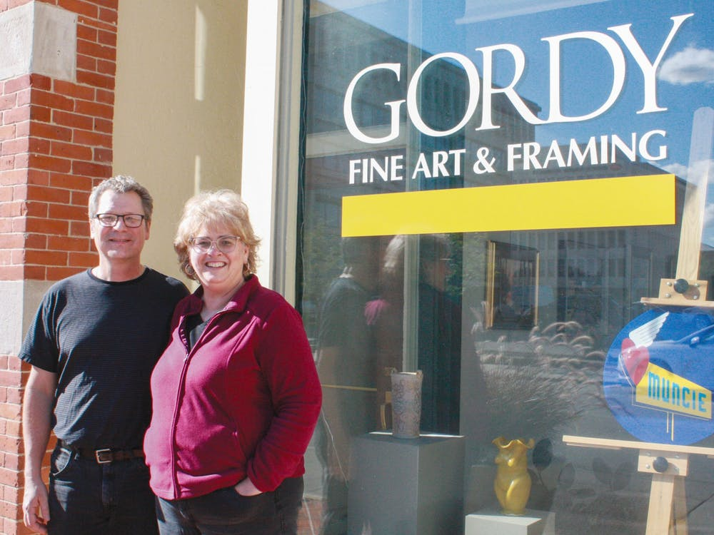 Carl and Barbara Schafer pose outside of Gordy Fine Art and Framing located at 224 E. Main Street, Sept. 9, 2021. Since purchasing Gordy in 2015, the Schafers have grown their reputation as a high-quality frame creation, reproduction and restoration shop. Samantha Lyon, DN