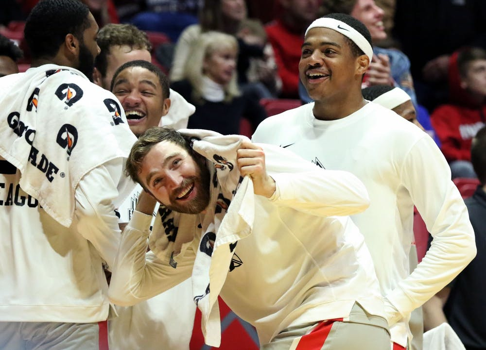 <p>Ball State junior guard Ishmael El-Amin, redshirt junior forward Brachen Hazen and redshirt freshman guard Jarron Coleman celebrate redshirt sophomore forward Miryne Thomas dunking during the Cardinals' game against Howard Saturday, Nov. 23, 2019, at John E. Worthen Arena. Ball State won 100-69. <strong>Paige Grider, DN</strong></p>