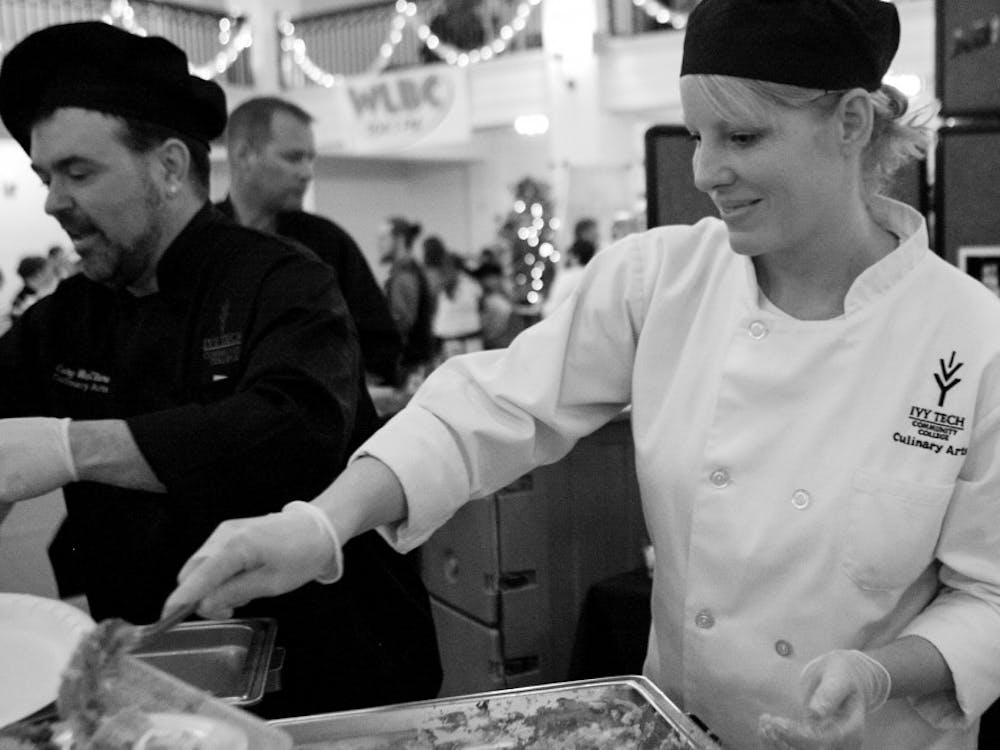 IVY Tech Student Alisha Mosier serves a dish made by students during the annual Taste of Muncie on Sunday the 21st.  Twenty two organizations that had booths with food for tasting at the Cornerstone Center of the Arts building downtown.  DN PHOTO JORDAN HUFFER