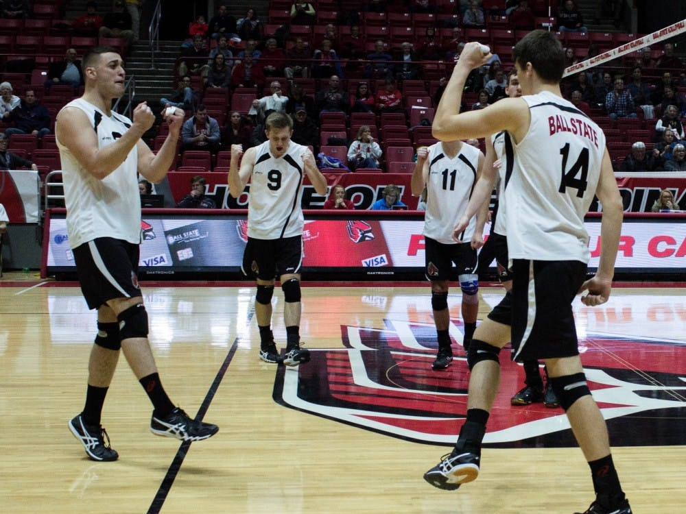 The Ball State men's volleyball team congratulates outside attacker Matt Szews on gaining a point for the team during the fourth set of the match against New Jersey Institute of Technology on Jan. 27 in Worthen Arena. Szews led the team with 11 kills, two aces and five digs. Grace Ramey // DN