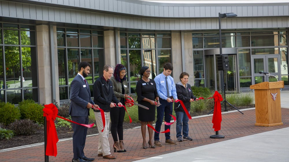 Ball State administrators and residence hall leaders cut the ribbon to inaugurate the north residential neighborhood Sept. 25. The neighborhood's renovation began in 2013 and was completed in fall 2021 with the opening of North West Residence Hall. Grace McCormick, DN