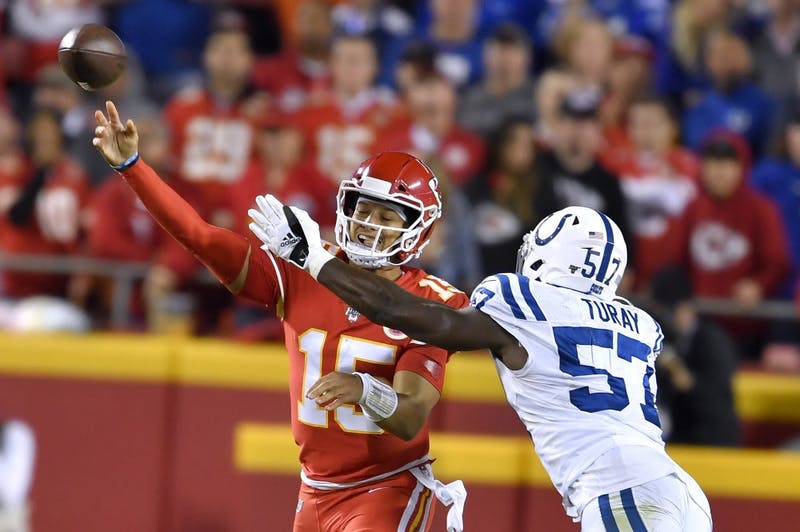 Kansas City Chiefs quarterback Patrick Mahomes (15) throws the ball before being hit by Indianapolis Colts defensive end Kemoko Turay (57) in the second quarter on Sunday, Oct. 6, 2019 at Arrowhead Stadium in Kansas City, Mo. (Rich Sugg/Kansas City Star/TNS)