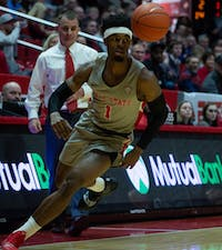 Redshirt junior guard K.J. Walton rushes towards the ball during the game against the University of Akron in John E. Worthen Feb. 16, 2019. The Zips fell to the Cardinals 57-56. Scott Fleener, DN
