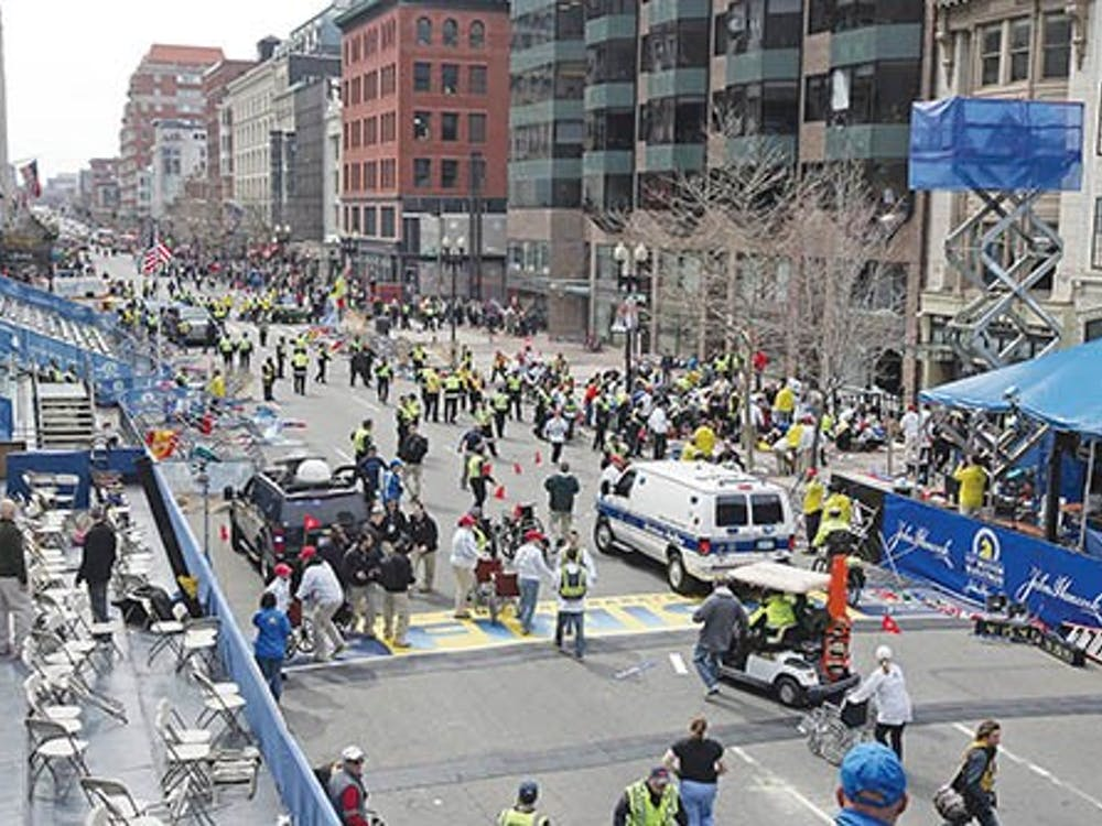 Emergency personnel assist victims at the scene of a bomb blast during the Boston Marathon on April 15, 2013. As of April 16, 2013, authorities didn't know who was responsible for the explosions. MCT PHOTO