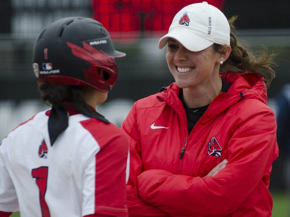 Head coach Megan Ciolli Bartlett talks with junior second baseman Maddy Labrador before her turn at bat during the second game of the double-header against Northern Illinois on April 4 at the Softball Field at the First Merchants Ballpark Complex. Ball State won 6-4. Emma Rogers // DN File