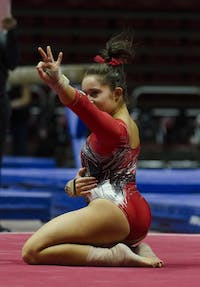 Sophomore Kaitlyn Menzione performs her floor routine at the meet against University of Kentucky on Jan. 29. Menzione scored a 9.9 for the routine. Emma Rogers // DN