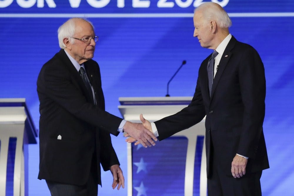 <p>Democratic presidential candidates Sen. Bernie Sanders, I-Vt., left, and former Vice President Joe Biden, shake hands on stage Friday, Feb. 7, 2020, before the start of a Democratic presidential primary debate hosted by ABC News, Apple News, and WMUR-TV at Saint Anselm College in Manchester, N.H. <strong>(AP Photo/Charles Krupa)</strong></p>