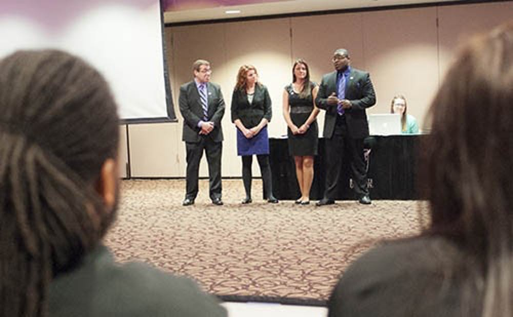 Cardinal United's presidential candidate Zeyne Guzeldereli, vice presidential candidate Alexa Gates, secretary candidate Fayeann Hurley and treasurer candidate Brandon Pope present their platform points to senators. Two members of the slate's campaign staff are accused of running an anonymous Twitter account that cyber bullied a senator.