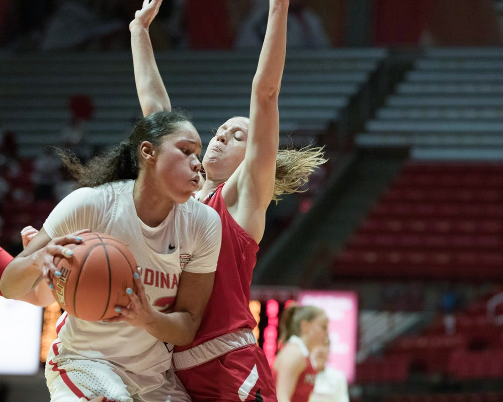 <p>Senior forward Oshlynn Brown gets guarded by a Miami Redhawks defender Jan. 27, 2021, at John E. Worthen Arena. The Cardinals took the win 85-82. <strong>Grace Walton, DN</strong></p>