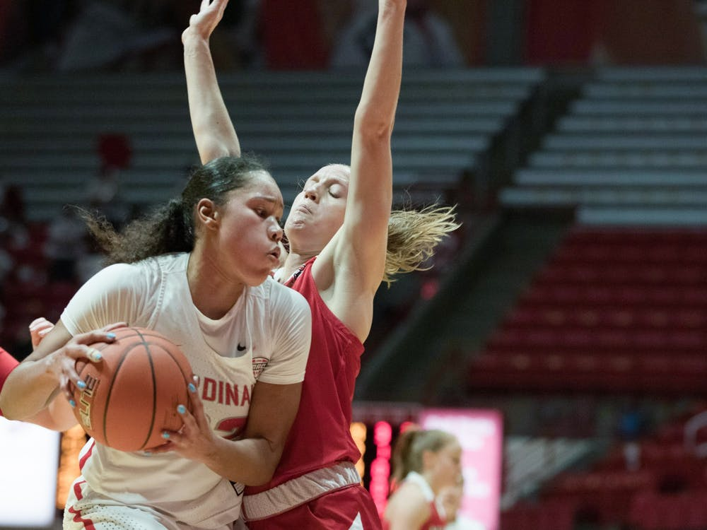 Senior forward Oshlynn Brown gets guarded by a Miami Redhawks defender Jan. 27, 2021, at John E. Worthen Arena. The Cardinals took the win 85-82. Grace Walton, DN