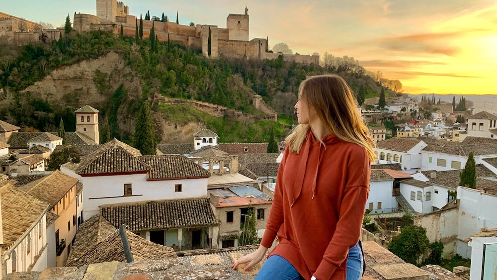In this March 2020 photo, Liz Rieth, junior journalism and Spanish major, looks out at the Alhambra Palace in Granada, Spain. Rieth returned home to Indiana from her study abroad program in Granada in early March. Liz Rieth, Photo Provided