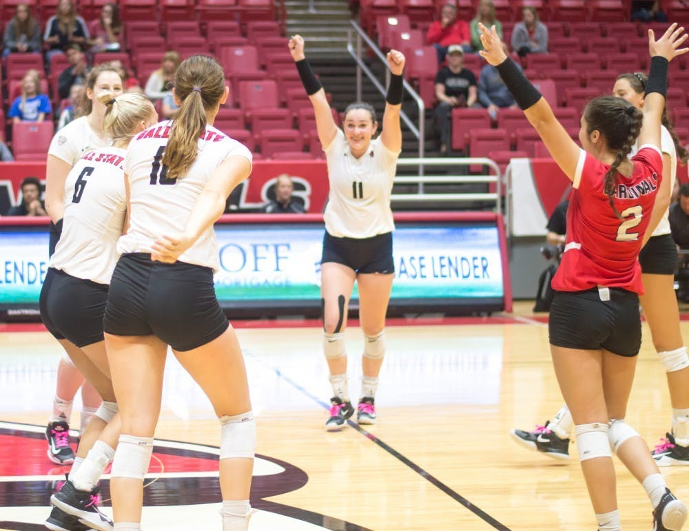 <p>Ball State's women's volleyball team celebrate after scoring against Western Michigan Friday, Oct. 6, 2017 in John E. Worthen Arena. The Cardinals won 3-1. Terence K. Lightning Jr., DN File</p>