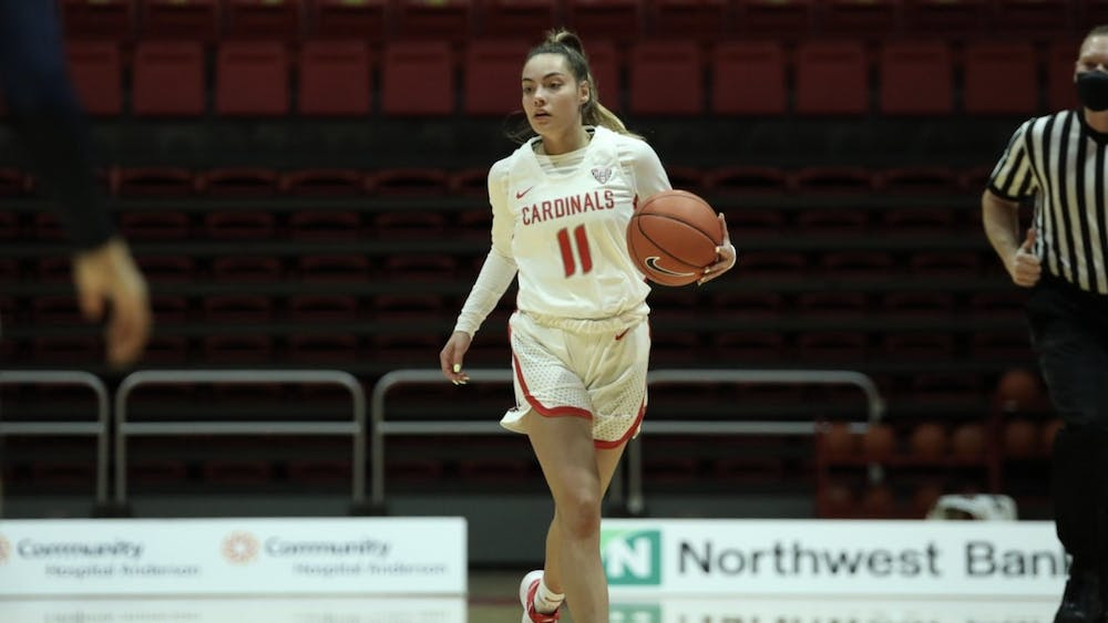 Cardinals sophomore guard Sydney Freeman dribbles the ball down the court Feb. 6, 2021, at John E. Worthen Arena. The Cardinals lost 89-84 to the Zips. Jacob Musselman, DN