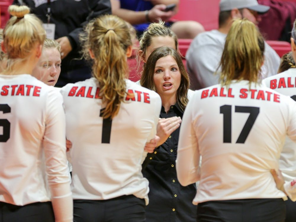 Head coach Kelli Miller gives a pep talk to the Ball State women's volleyball team before their final home game of the season against the University of Toledo at John E. Worthen Arena on Nov. 2. This is Millers second year coaching the women's volleyball team after leading them to a second-place finish in the Mid-American Conference West Division last year. Elliott DeRose, DN