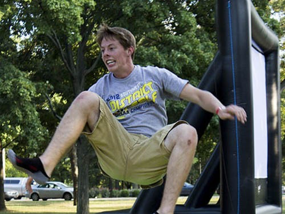 Brandon Groff jumps in a bounce house during the University Program Board Quad Bash on Friday. The event included inflatables and food. DN PHOTO TAYLOR IRBY
