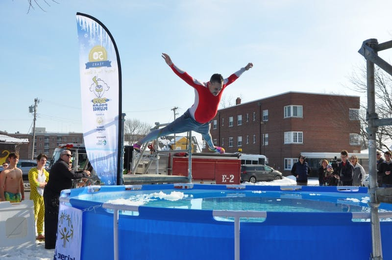 A volunteer belly flops into a pool of cold water at the annual Special Olympics Indiana Polar Plunge Saturday, Feb. 2, 2019, at the L.A. Pittenger Student Center. This year's plunge raised an estimated $20,000, more than any other previous plunge at Ball State. Jacob Musselman, DN