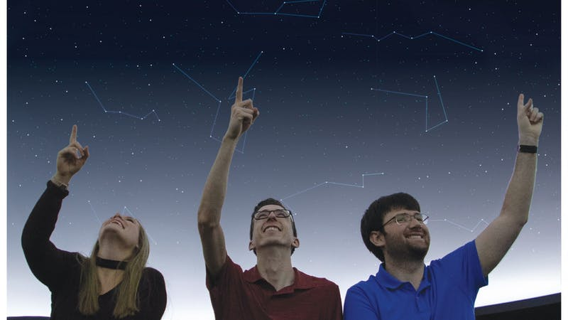 Brielle Tilson, graduate assistant in the Department of Physics and Astronomy, Kyle Koeller, junior astronomy major, and Daniel Brosser, second year master's student, sit in the Charles W. Brown Planetarium Nov. 19, 2019. Tilson, Koeller and Brossard are part of the planetarium's student staff. Jacob Musselman, DN Illustration; Freepik, graphic courtesy; Emily Wright, DN Illustration