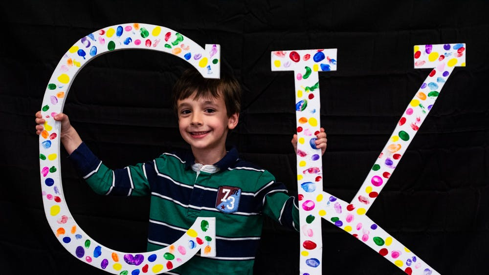 "A Camp Kesem attendee, nicknamed ""Cheese Pizza,"" holds letters at the annual Make the Magic Gala fundraiser. This year, Camp Kesem will hold an online summer program to prevent the spread of COVID-19. Audrey Williams, Photo Provided"