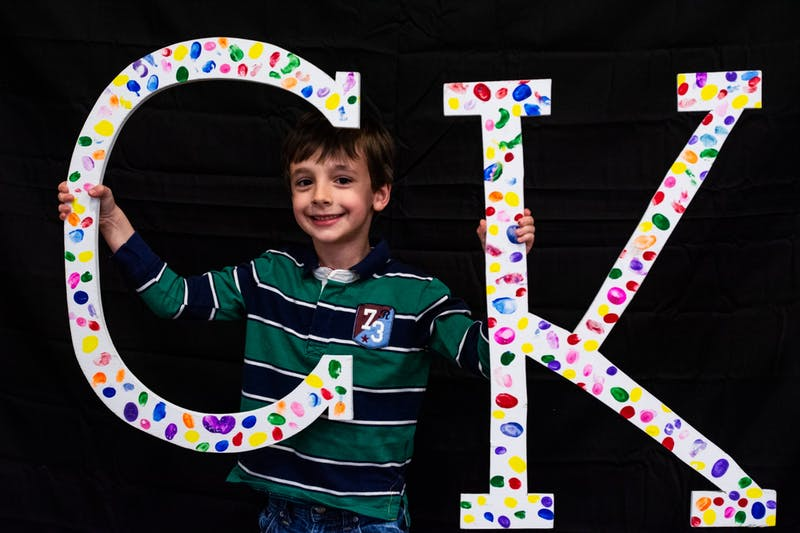 """A Camp Kesem attendee, nicknamed """"Cheese Pizza,"""" holds letters at the annual Make the Magic Gala fundraiser. This year, Camp Kesem will hold an online summer program to prevent the spread of COVID-19. Audrey Williams, Photo Provided"""