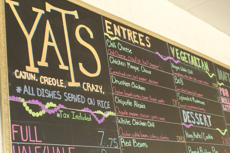The Yats menu chalkboard displays available food items at the downtown Muncie location. Dan Tosson, who previously managed stores in Cincinnati and Noblesville, Indiana, currently manages the Village location. Amelia Cisna, DN