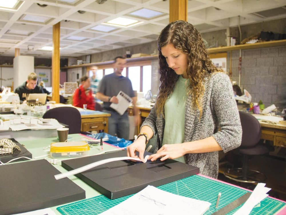 Denise Blankenberger, a sophomore architecture major, works on a model that she based on zebra stripes. Architecture students spend many hours working on their projects in the Architecture Building. DN PHOTO EMMA ROGERS