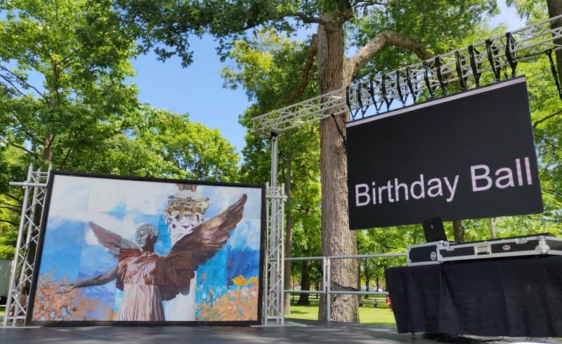 "The ""Beneficence Mural"" stands on stage after being presented at the Centennial Closing celebrations June 14, 2019, at the Quad. President Geoffrey Mearns sent out a campus-wide email asking the campus community for suggestions regarding its location. Rohith Rao, DN"
