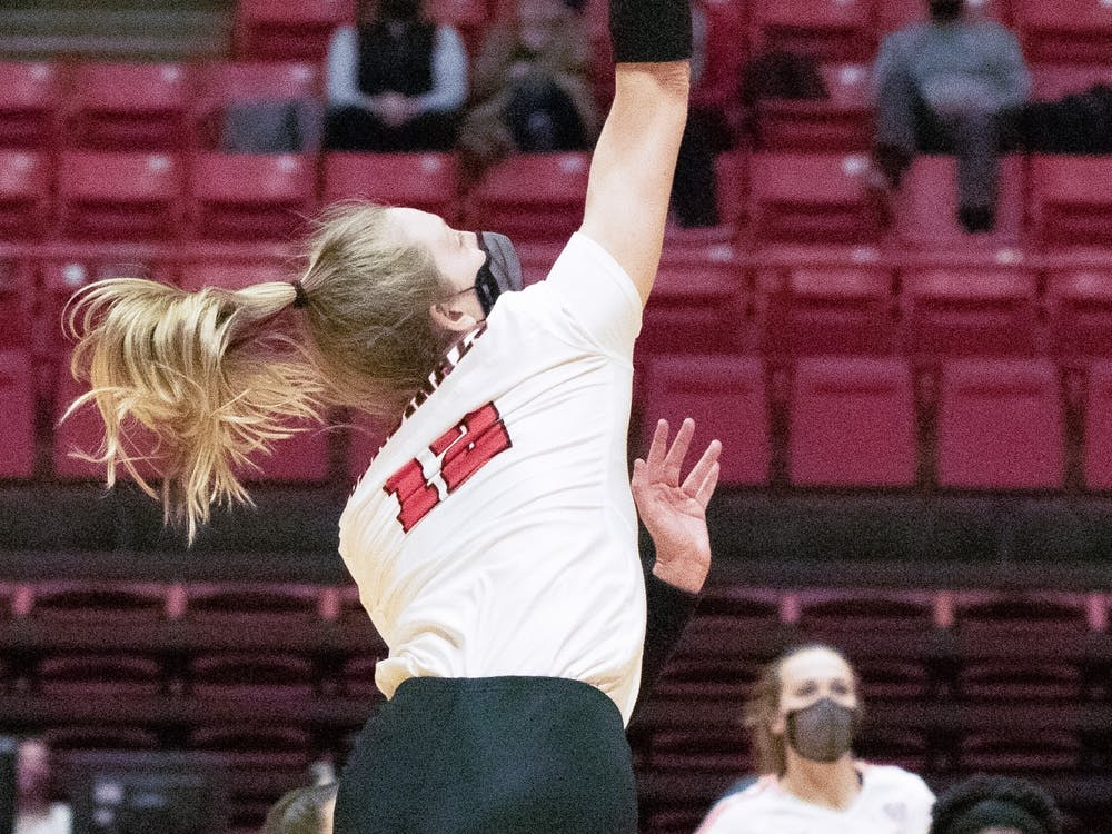 Freshman outside hitter Cait Snyder kills the ball Feb. 12, 2021, in John E. Worthen Arena. The Cardinals lost to the Falcons 0-3. Madelyn Guinn, DN