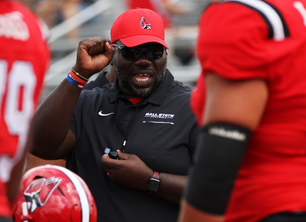 <p>Offensive line coach Colin Johnson runs the offensive line through drills before Ball State's game against Fordham on Saturday, Sept. 7, 2019 at Scheumann Stadium. Ball State won 57-29. <strong>Paige Grider, DN</strong></p>