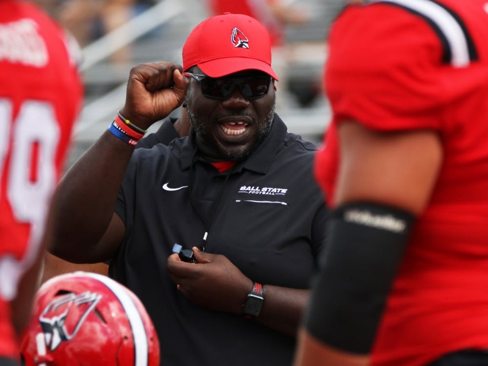 Offensive line coach Colin Johnson runs the offensive line through drills before Ball State's game against Fordham on Saturday, Sept. 7, 2019 at Scheumann Stadium. Ball State won 57-29. Paige Grider, DN