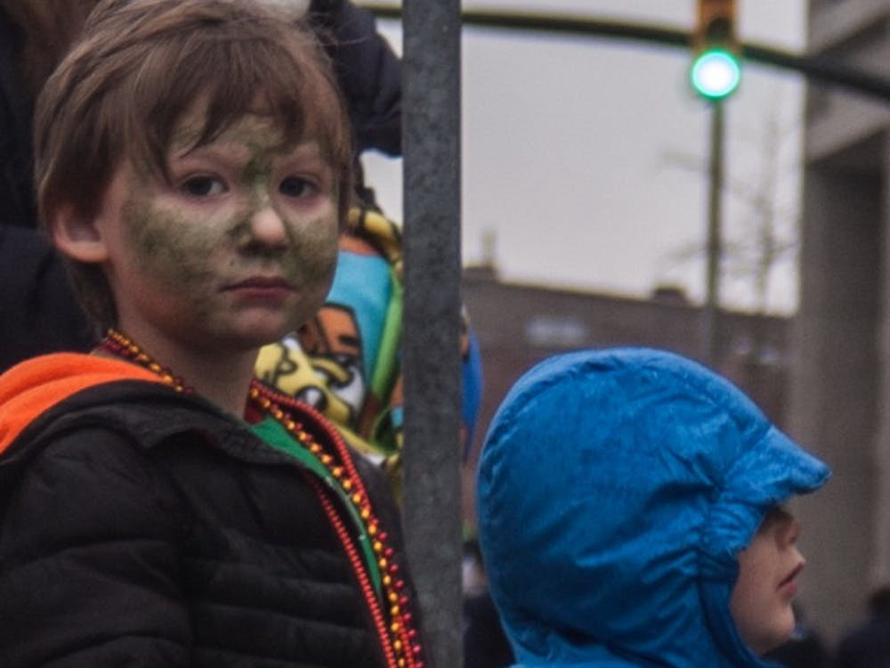 Muncie residents endured snow, rain and hail to receive candy at the annual St. Patrick's Day Parade, March 17.