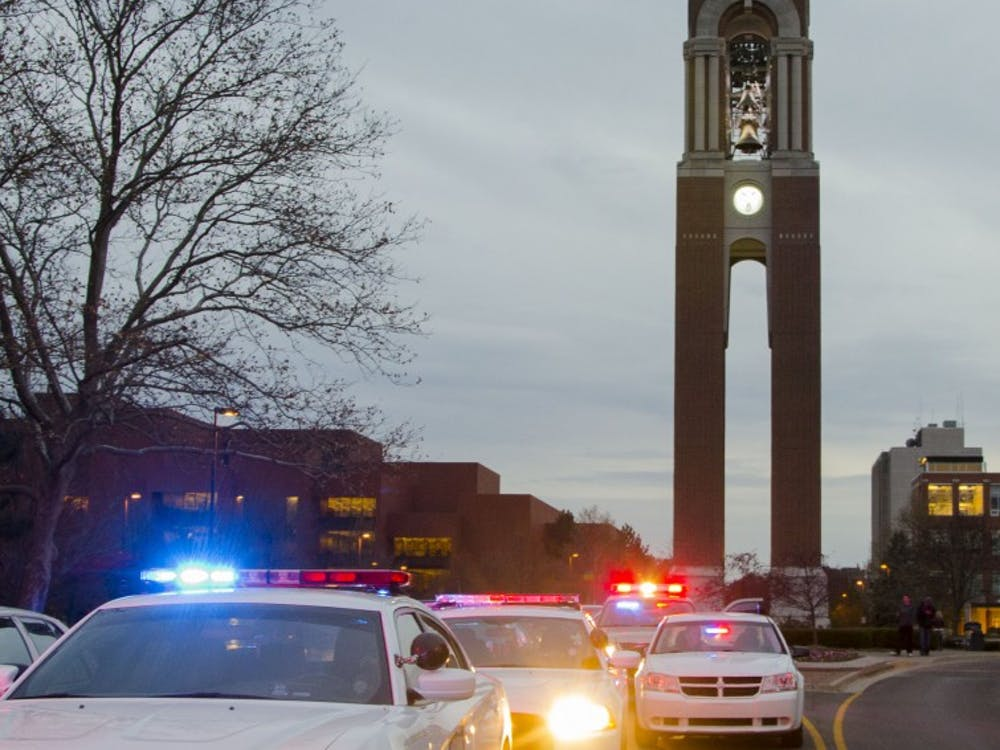 Police cars line the street outside of the Robert Bell building after the report of an armed assailant Nov. 15 at the Student Recreation and Wellness Center. DN PHOTO TAYLOR IRBY