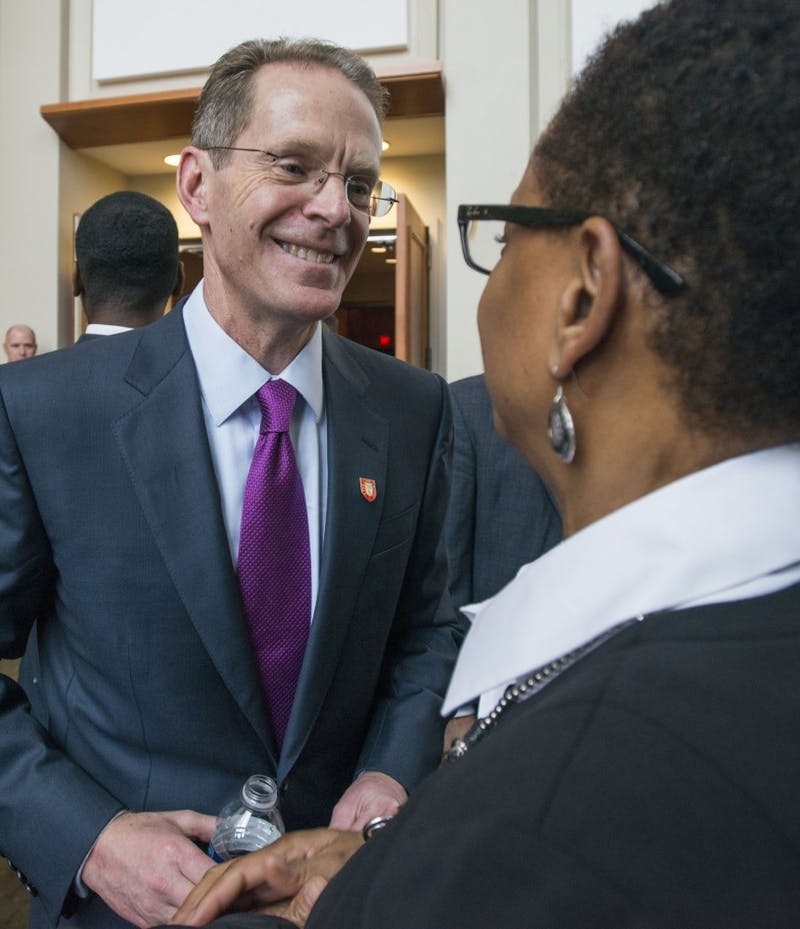 Geoffrey S. Mearns talks to Charlene Alexander, associate provost for diversity and director of office of institutional diversity, after the ceremony on Jan. 24 in the lobby of Sursa Hall. Breanna Daugherty // DN