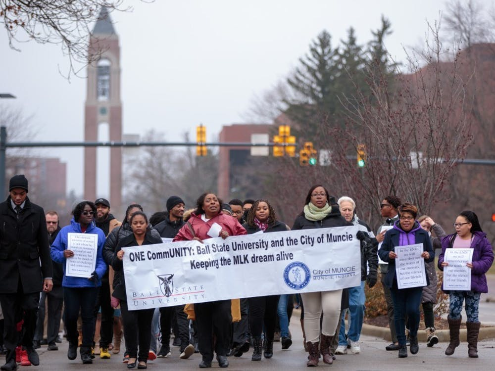 Ball State students and Muncie community members march on McKinley Avenue for the Unity March, Jan. 16, 2017. This year's Unity March was canceled due to the COVID-19 pandemic, but Ball State will still welcome guest speakers via Zoom and host events for Unity Week. Kyle Crawford, DN File