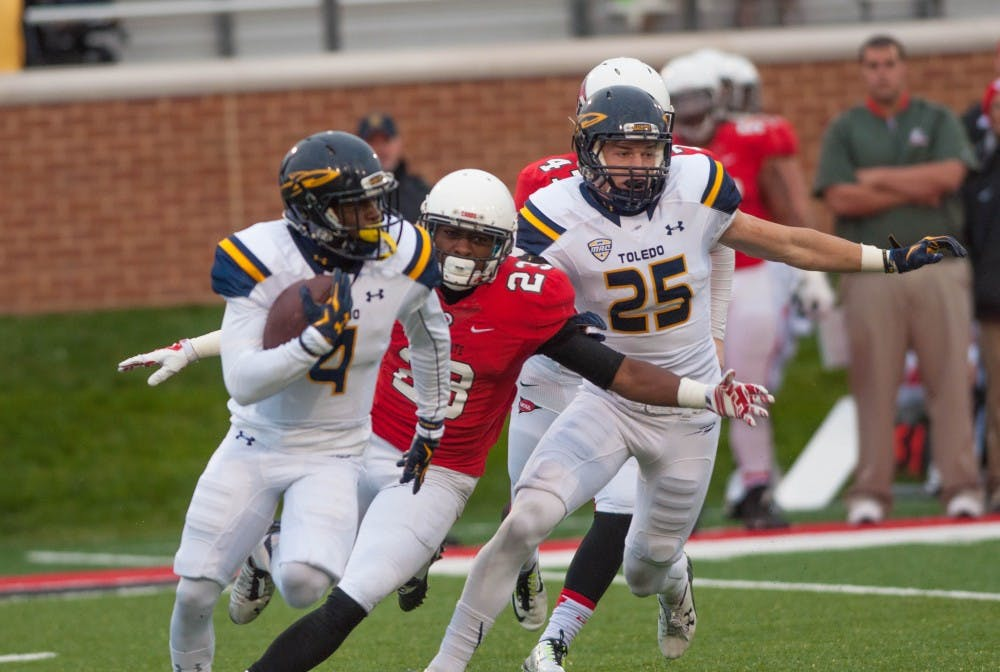 Defensive Back Marc Walton tries to tackle Toledo wide reciever Corey Jones on Oct. 3 at Scheumann Stadium. Ball State University lost to the University of Toldeo with a score of 24-10. DN PHOTO JASON CONERLY