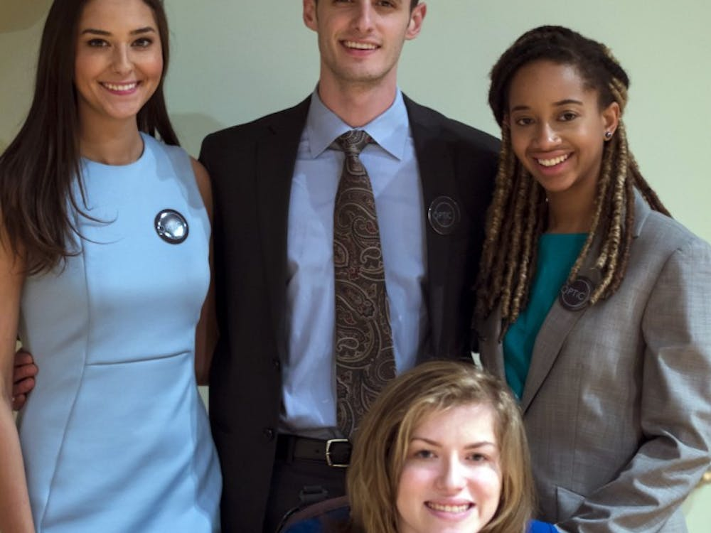 Juniors Katy Volikas, Greg Carbo, Kaia Thompson and Lizzie Ford are running for 2017-18 SGA executive board. Their slate, OPTiC, participated in the All Slate Debate on Feb. 20 in John J. Pruis Hall. Terence K. Lightning Jr. // DN