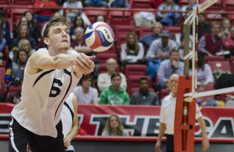 Pair of men's volleyball players competing against 'best friend'
