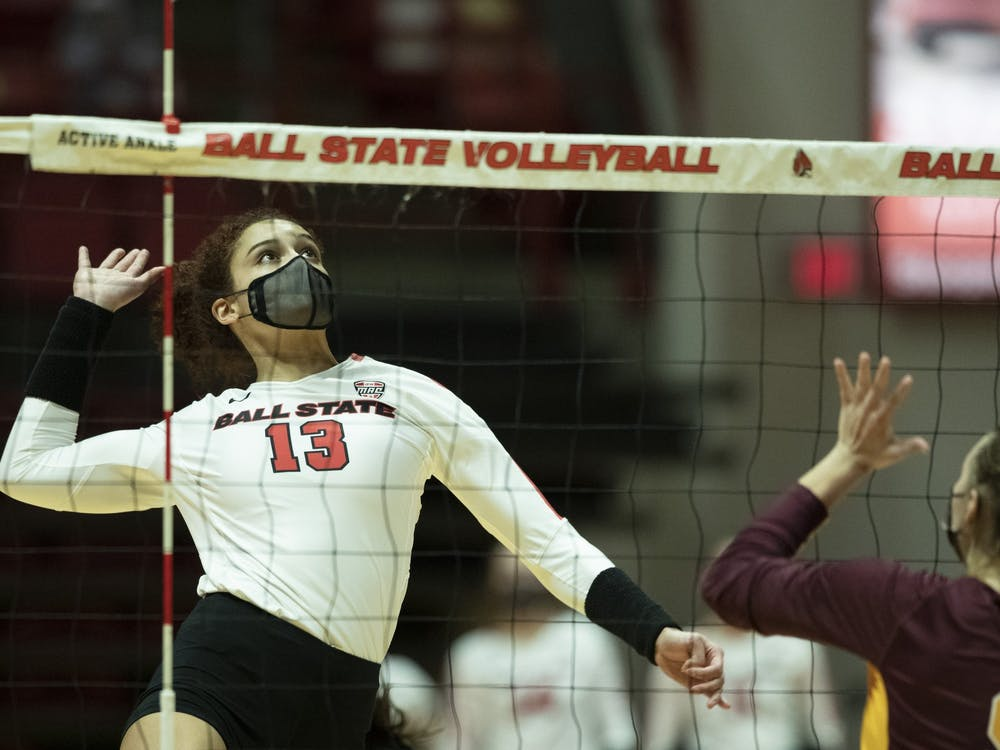 Cardinals sophomore outside hitter Natalie Mitchem goes up for a spike against Central Michigan University March 19, 2021, at John E. Worthen Arena. The Cardinals beat the Chippewas 3-2. Jacob Musselman, DN