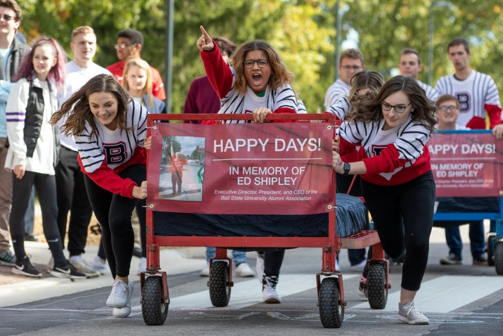 <p>Students from the Ball State University Singers organization take off during the 2019 Ball State University Bed Race Oct. 18, on Riverside Ave. Bed races have been a Homecoming Week traditional at BSU since 1980. <strong>Kyle Crawford, Byte File</strong></p>