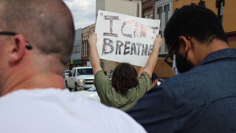 """Duncan Bellard, a Hartford City, Indiana, resident, holds a sign saying, """"I can't breathe,"""" May 30, 2020, near the junction of Walnut and Main streets in downtown Muncie. Bellard came from his hometown, located 30 minutes away, for the protest. Bailey Cline, DN"""