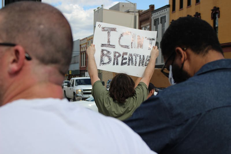 "Duncan Bellard, a Hartford City, Indiana, resident, holds a sign saying, ""I can't breathe,"" May 30, 2020, near the junction of Walnut and Main streets in downtown Muncie. Bellard came from his hometown, located 30 minutes away, for the protest. Bailey Cline, DN"