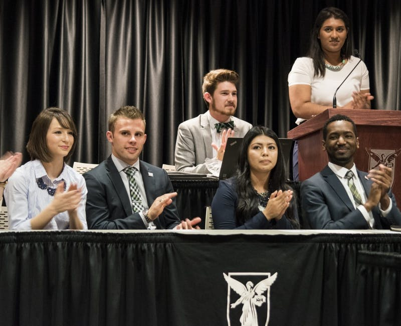Emily Halley, treasurer; Brock Frazer, secretary; Ana Batres, vice president; and James Wells, president, all sit in the front of the Senators at the L.A. Pittenger Student Center.  on April 20 for their inauguration to be the next executive board for the 2016-2017 semester. DN PHOTO STEPHANIE AMADOR